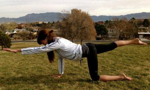 flying dog yoga posture
